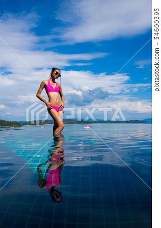 Skinny Tanned skin asian woman bikini swim pool 54600395