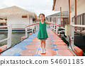 Adorable little Asian kid girl open wide arms. 54601185