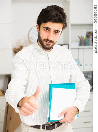 Portrait of young cheerful businessman 54604293