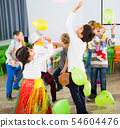 Kids and teacher playing with balloons 54604476