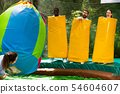 People as bowling pins in an amusement park on a summer sunny day 54604607
