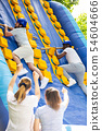 Inflatable slide Great race - climbing with a stick on an inflatable trampoline 54604666