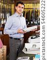 Salesman offering accessories for hunt 54605222