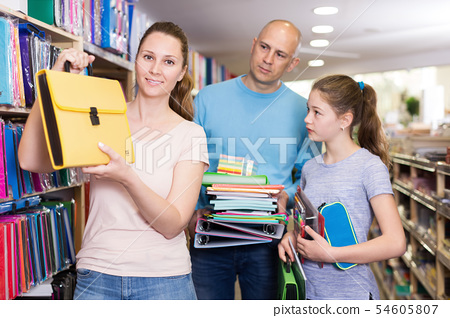 Friendly family visiting shop of stationery in search of school supplies 54605807