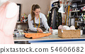 Woman professional measuring textile material at atelier 54606682