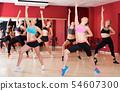 Women dancing in class 54607300