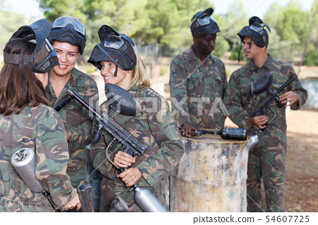 Female paintball team discussing tactic of game 54607725