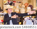 Portrait of happy male try on hat 54608551