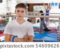 Unhappy tired teenage boy in sportswear 54609626