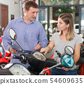 Man with woman are choosing modern motobikes 54609635