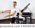Ballet lesson in the studio. Choreographer plays the piano 54609638
