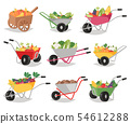Vegetables in wheelbarrow healthy nutrition of vegetably tomato pepper and carrot in wheel barrow 54612288