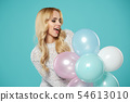 Happy young woman with colorful latex balloons 54613010