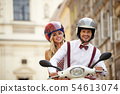 Hipster  couple riding a scooter on a sunny day in 54613074