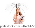 Young girl under an umbrella carrying some 54621422