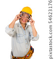 Hispanic Female Contractor in Goggles and Hard Hat 54623176