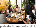 Friends have lunch eat together on wooden table 54626816