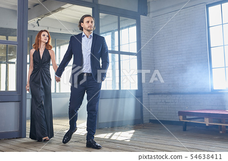 stylish actors posing on a concrete background 54638411
