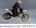 Motocross bike in a race representing 54639352