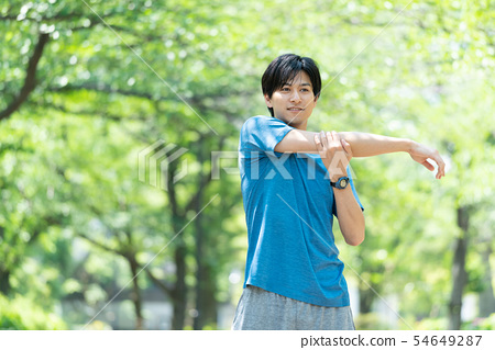 Jogging exercise young man image 54649287