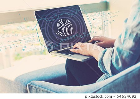 Fingerprint scanning theme with woman using laptop 54654092