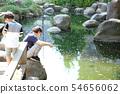 ผู้ปกครองและเด็ก ๆ ทำการตกปลาน้ำเค็ม 54656062