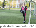 portrait of woman at the football goal 54657923