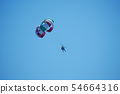 Parachutists flying in a pair under one dome again 54664316
