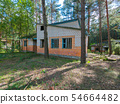 thrown brick houses with wooden windows in a conif 54664482