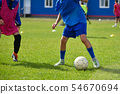 Young football players play football in training 54670694