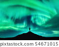 Aurora borealis and silhouette of a man 54671015