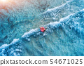 Aerial view of a young woman swimming in the sea 54671025