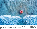 Aerial view of a young woman swimming in the sea 54671027