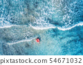 Aerial view of a young woman swimming in the sea 54671032