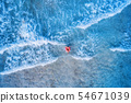 Aerial view of a young woman swimming in the sea 54671039