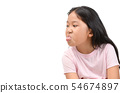 Girl with funny expression and sticking tongue out 54674897