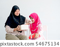 Muslim little girl look happy and surprise of gift 54675134