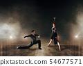 Elegant dancers, pair dancing on stage 54677571