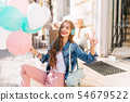 Cheerful young lady with everyday make-up posing 54679522