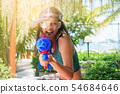 Asian woman are ready to fight with water gun 54684646