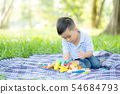 Little boy is playing for idea and inspiration 54684793