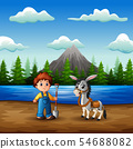 Young farmer with a goat in the river 54688082