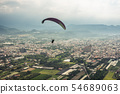 colorful paragliding over blue sky at town 54689063