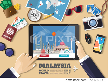 Hand holding smart tablet booking travel 54692548