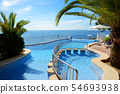The swimming pool and turquoise water in hotel 54693938