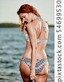 Back view of perfect woman in bikini with bonnet 54699530