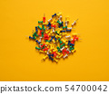 Colorful pushpins on yellow 54700042