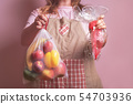 Woman holding eco bag with groceries and plastic 54703936