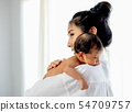 Asian mother hold baby place upon her shoulder 54709757