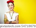 young pretty mexican woman smiling happy on yellow background, lifestyle people concept 54710679